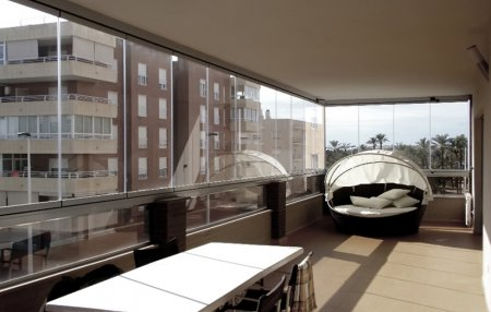 Особенности безрамного остекления балкона